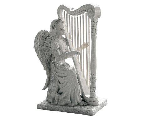 angel playing the harp garden statue